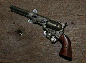 Percussion Pistol Mounted on a Board