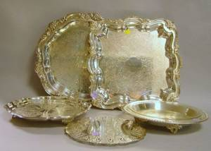 Four Assorted Silver Plated Serving Trays and a Trivet