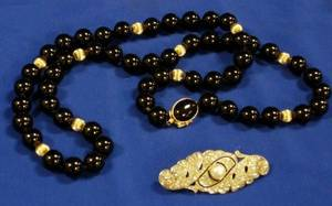 Strand of Onyx and Gold Beads 14kt Gold Clasp and a French Art Deco Paste Brooch
