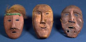 Three Carved Wood Inuit Masks