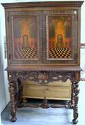 Berkey  Gay Furniture Jacobeanstyle Inlaid and Paint Decorated TwoDoor Walnut Veneer Linen Cabinet on Stand
