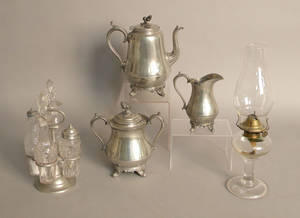 Boardman three piece pewter tea service together with a cruet set and an oil lamp