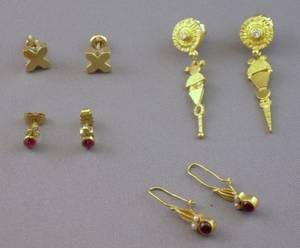 Pair of 18kt and a Pair of 22kt Gold and Ruby Earrings a Pair of 22kt Gold and Diamond Earrings and a Pair of