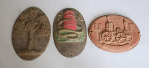 Three cast iron fire marks