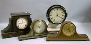 Three Mantel Clocks and a Marinestyle Plastic Cased Wall Clock