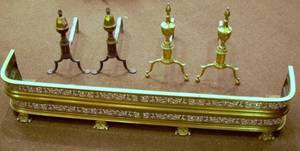 Two Pairs of Brass Andirons and a Pierced Brass Fireplace Fender