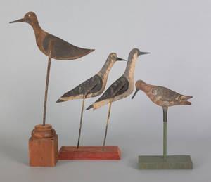 Four tinnie shore bird decoys late 19thearly 20th c