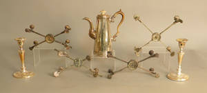 Four silver plated dish crosses together with a pair of candlesticks and a coffeepot