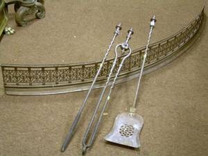 Bowed Pierced Steel Fireplace Fender and a Set of Three Steel Fireplace Tools