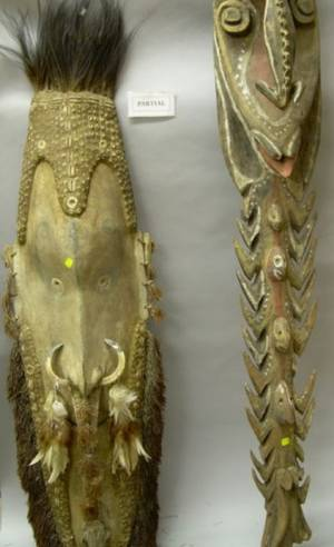 Two Large New Guinea Carved Painted and Embellished Wooden Masks and a Carved Wooden Sculpture