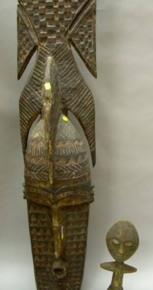 Large African Carved and Painted Wooden Mask and an Ivory Coast Carved Wooden Figure