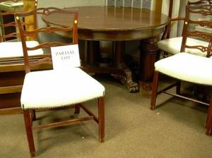 Potthast Bros Georgianstyle Carved Mahogany Dining Table and a Set of Six Chippendalestyle Mahogany Dining Chairs