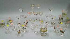Thirtyfour Pieces of Mid20th Century Enamel Sport and Floral Decorated Glass and Stemware