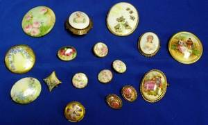 Fifteen Painted Porcelain Brooches and a Pair of Earrings