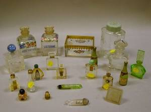 Collection of Fourteen Perfume Bottles and Six Glass Dresser Articles