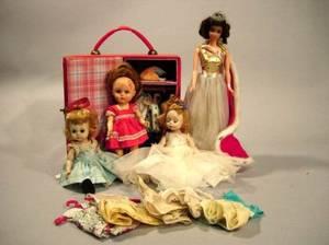 Four Small Plastic Dolls