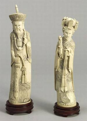 Pair of Chinese Carved Ivory Figures of a Mandarin and his Consort