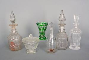 Blown colorless glass decanter together with three other decanters