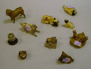 Group of Nine Metal Pugrelated Articles and a Miniature Painted Ceramic Basket of Pugs Figural Group