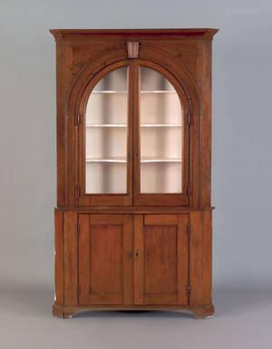 Pennsylvania walnut architectural corner cupboard in two parts ca 1800