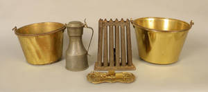 Two brass buckets together with a candlemold