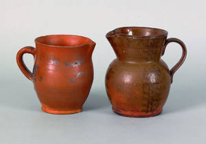 Two redware pitchers 19th c