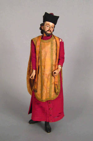 Continental carved and painted figure of a cleric early 19th c