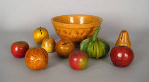 Nine painted redware fruit banks late 19th c