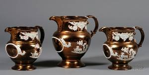 Set of Three English Earthenware Copper Lustre Pitchers