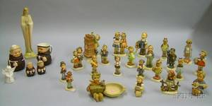 Twentythree Hummel Ceramic Figures and Figural Items and Five Goebel Ceramic Items