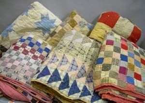 Six Pieced Cotton Patchwork Quilts and a Pieced Cotton Star Pattern Quilt