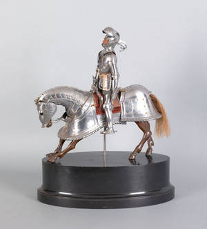 Mixed metal and carved articulated wood figure of a knight on horseback late 19th c