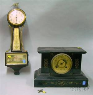 New Haven Ironcased Black Mantel Clock and a Westinghouse Electric Banjo Clock