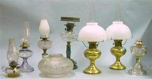 Five Assorted Late Victorian Glass Kerosene Table Lamps and a Pair of Aladdin Brass Kerosene Lamps with Milk Gl