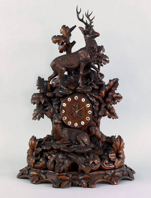 Black Forest carved mantle clock late 19th c
