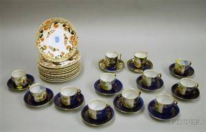 Set of Ten Imari Palette Ceramic Plates and a Near Set of Twelve Decorated Porcelain Demitasse Cups and Saucers
