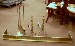 Pair of Urn Finial Andirons a Reticulated Brass Fender and a Tool Stand with a Set of Three Tools