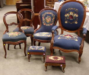 Four Victorian Rococo Revival Needlepoint Upholstered Walnut Parlor Chairs and Two Footstools