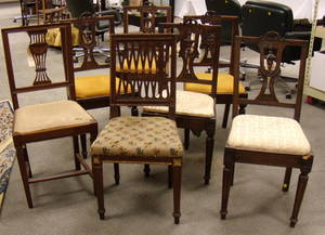 Two Italian Neoclassical Carved Walnut Side Chairs and a Set of Five Italian Neoclassical Carved Walnut Side Chairs