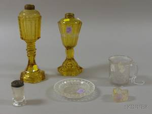 Two Amber Etched and Cut Glass Fluid Lamps and Four Colorless Pressed Glass Items