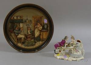 German Molded Pottery Genre Scene Plaque and a Dresdenstyle Porcelain Figural Group