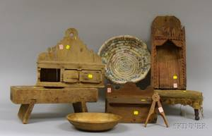 Three Wooden Wall Boxes a Carved Wooden Nutcracker Two Wooden Stools a Turned Wooden Bowl and a Coiled Rag