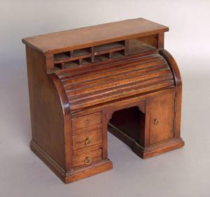 Miniature mahogany roll front desk
