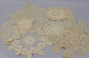Four Crochet Lace Doilies and a Fivepiece Crochet Lace Table Suite