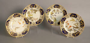 Set of four Royal Worcester plates with reticulated cobalt border and floral decoration