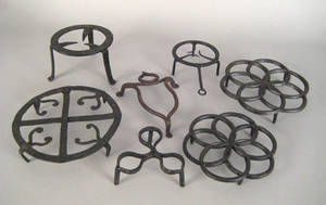 Seven Pennsylvania wrought iron and cast iron trivets early 19th c