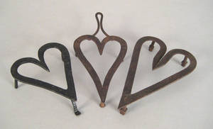 Two heart shaped wrought iron trivets 19th c