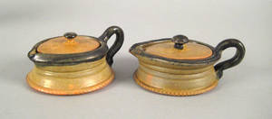 Two Isaac Stahl redware syrups dated 1938