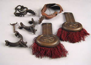 Pair of engraved iron spurs 19th c
