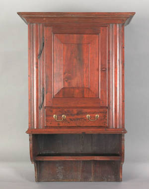 Pennsylvania pine and walnut hanging cupboard early 20th c